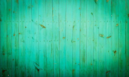 Green wood background. Close-up view of old wood wall colored in green.