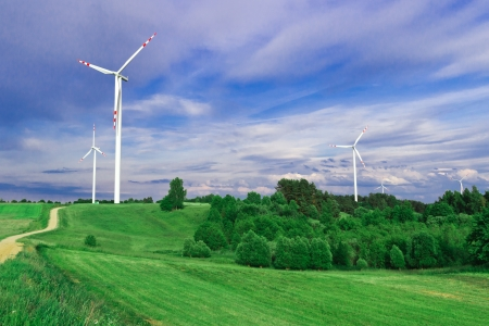 Wind turbine, renewable energy  Landscape with blue sky  Stock Photo