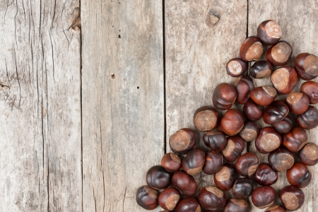 Closeup chestnuts on wooden desk