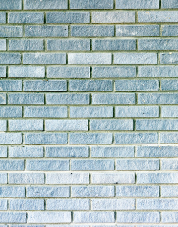 Background texture of a grey brick wall photo