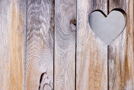 The wooden door with heart. Background
