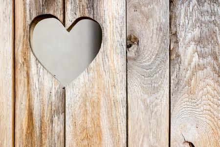 The wooden door with heart. Background photo