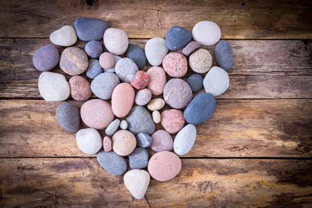 Stone heart on a wooden background