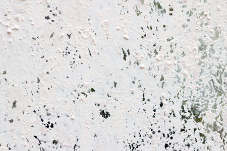 Corroded surface with chipped white paint background