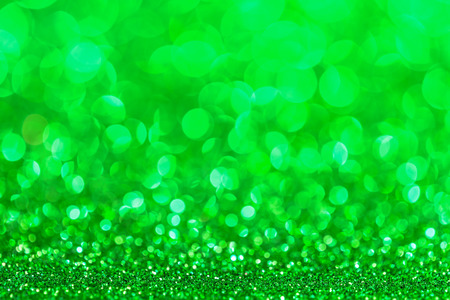 green backgrounds: Festive Christmas background. Abstract twinkled bright background with bokeh defocused lights