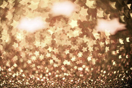 glowing star: Festive Christmas background with stars. Abstract twinkled bright background with bokeh defocused lights Stock Photo