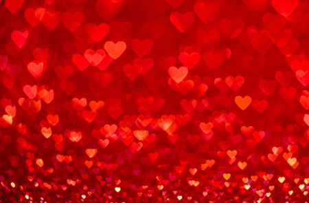 Red heart bokeh background. Valentines day texture.