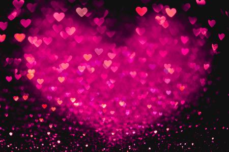 Rood hart bokeh achtergrond. Valentijnsdag textuur.
