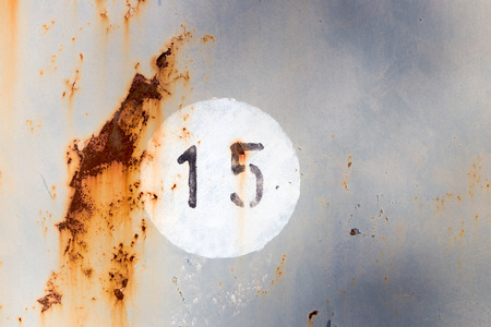number 15: Number 15 on old painted and rusted metal panel Stock Photo