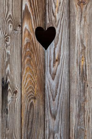 The wooden door with heart. Background