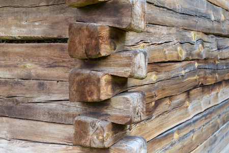 Wood corner of a old building with dovetail joints. Stock Photo