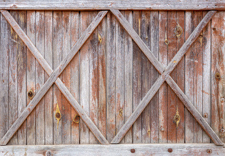 Old wooden door - grunge background texture for design.