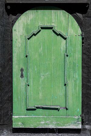Old green wooden door - grunge background texture for design.
