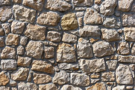 Background of stone wall texture photo.