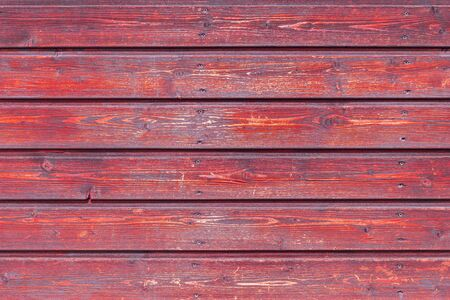 Old red painted boards for use as a background.