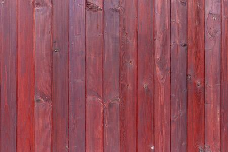 The old red wood texture with natural patterns. Stockfoto