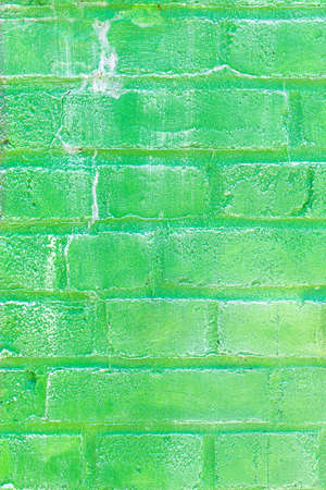 Background texture of a old green brick wall.