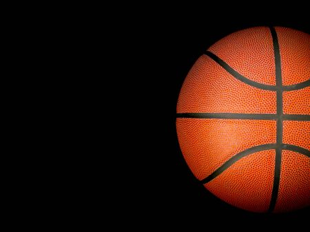 Basketball ball over black