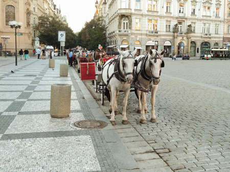 Prague, Czech Republic - September 27, 2020: horse-drawn carriage, Old Town Square markets, restaurants, People crowded at the Old Town Square in Prague