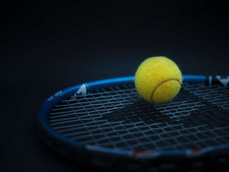 Sport and healthy lifestyle. Tennis. Yellow ball for tennis and a racket on table. Sports background with tennis concept, photo