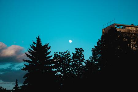 somewhere: Moonrise in the neighbourhood somewhere in Romania Stock Photo