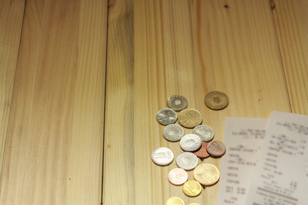 A Few Romanian Leu Next To Some Grocery Receipts On A Wooden Stock