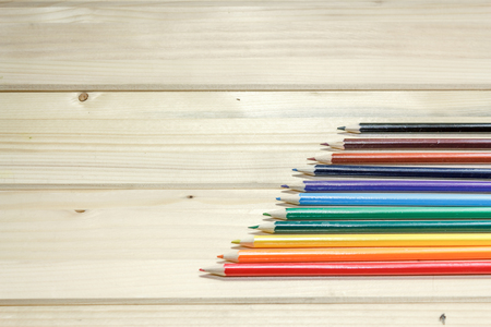 study group: A group of ascended placed colorful pencils on a wooden table