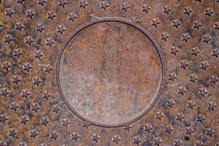 aluminium: Shot to a texture of a sewer top cover made from metal with a few stars