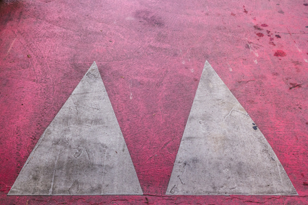 Close up shot to a marked red speed bump from the top
