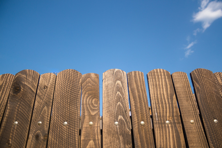 Beautiful shot to a wooden fence with a great blue sky in the backround
