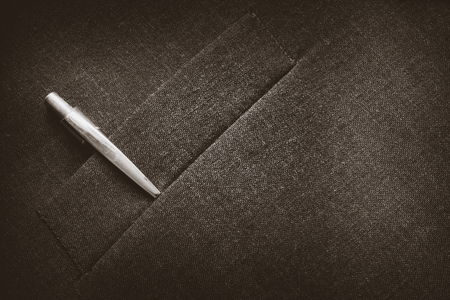 metalic: Closeup of a suit pocket with a metalic pen on a business coat