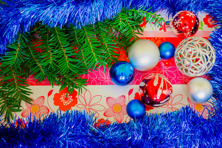 silver: Christmas background with pine tree branches, decorations and baubles on floral board