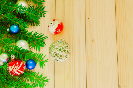 silver: Christmas background with pine tree branches and baubles on wooden board