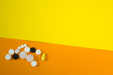 closeup to drugs pills on pink background Stock Photo