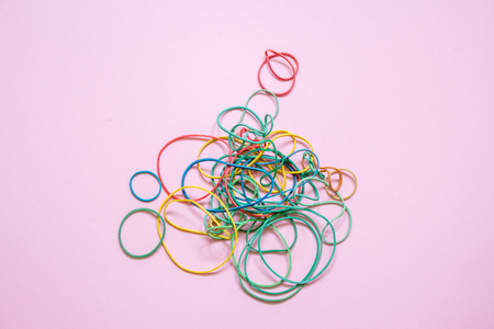 A multicoloured background showing a heap of colourful elastic rubber bands Stock Photo