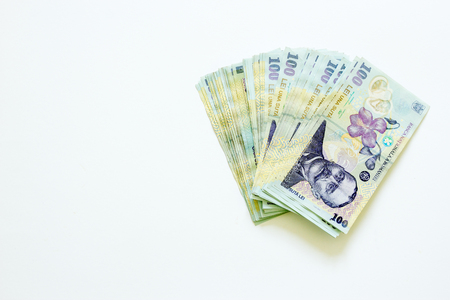 Romanian currency banknotes unfolded on white background