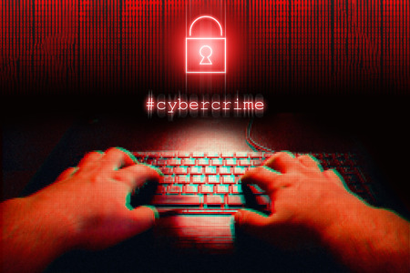 spy ware: Hands in the dark typing on keyboard. Black copy space Stock Photo