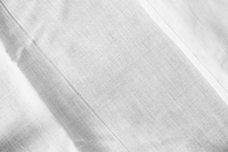 White background of crumpled sheet fabric texture Stock Photo