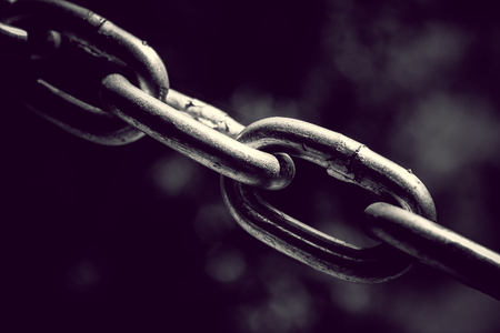 Stainless steel chain links. Industrial metal background