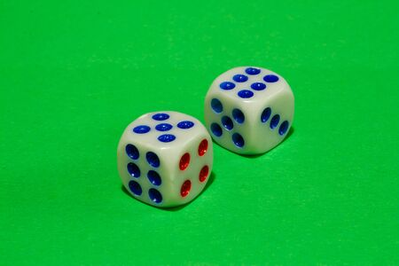 Isometric shot of two dices on green background. Casino gambling concept image
