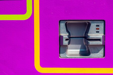 Close up shot to an ATM card with purple background and colorful lines – Withdrawal concept image Foto de archivo