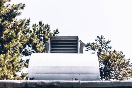 Big metallic rectangle air vent sitting on a building rooftop – Exterior ventilation system used for temperature adjustment Reklamní fotografie