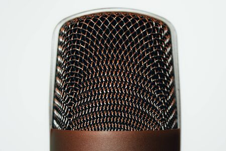 Closeup shot of a grid metallic head of a big retro microphone on a with background – Music studio professional equipment for voice recording – Concept image for freedom of speech Standard-Bild