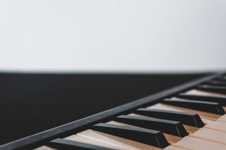 Retro piano keyboard with black and white keys on a white background with copy space – Musical instrument used for creative melodic compositions Standard-Bild