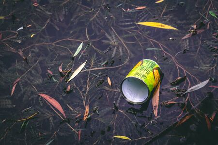 Empty aluminum can, thrown in the water in a natural park – Left overs that are damaging the environment