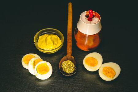 Egg slices and halves next to spices – Organic food to be served for lunch in the morning – Keto diet table