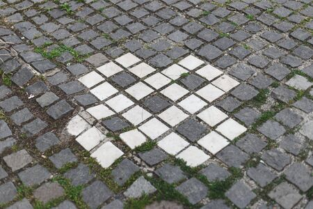 Grey and white cubic stone with vintage pattern - Solid and durable tiles used for street pavement - Decorative geometric gravel used for fancy pathways and sidewalks
