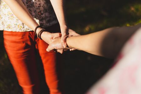 Holding old hands - Young woman being affectionate while holding a senior woman by her arm - Senior carrying concept image