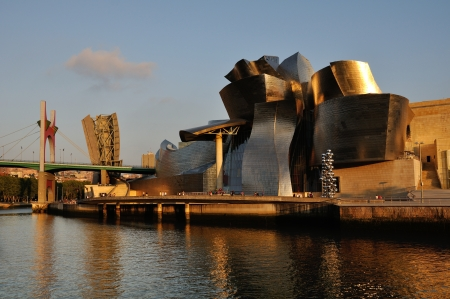 Bilbao, Spain - July 30, 2011  Famous Guggenheim Museum - symbol of modern city, taken in the late evening with the low sun