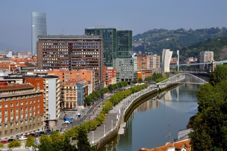 Aerial view of Bilbao city downtown with a Nevion River, Zubizuri Bridge and promenade